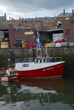 Boats and houses in Eyemouth, old fishing town in Scotland, UK.  07.08.2015 Stock Photos