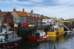 Boats and houses in Eyemouth, old fishing town in Scotland, UK.  07.08.2015 Royalty Free Stock Image