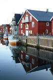Boats and houses of  Hennigsvaer's Canal Grande Royalty Free Stock Photos
