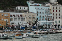 Boats and houses in sea port. Capri's sea port in the afternoon Royalty Free Stock Photo