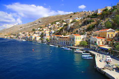 Boats and houses on symi island,Greece Stock Images