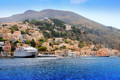 Boats and houses on symi island, Greece Stock Photo