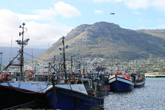 Boats in Houtbaai harbor stock photography