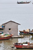 Boats and hut with poor living Stock Images