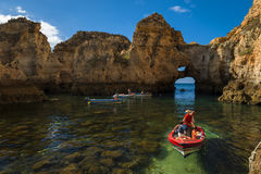 Boats In The Small Bay Between The Sandstone Cliffs At The Ponta Da Piedade In Lagos, Portugal Royalty Free Stock Photography