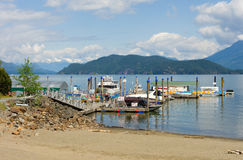 Boats and jet skis for hire on the water at harrison hot springs, bc. A water-craft rental dock as seen on a lake in the canadian rockies Stock Images