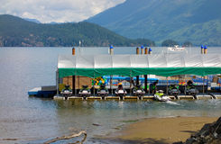 Boats and jet skis for hire on the water at harrison hot springs, bc. A water-craft rental dock as seen on a lake in the canadian rockies Stock Photography