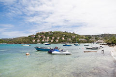 Boats and Jet Skis by Resort Beach Stock Photography
