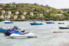 Boats and jet Skis  by Tropical Resorts Stock Image