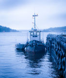 Boats by a Jetty in the fjord Royalty Free Stock Images