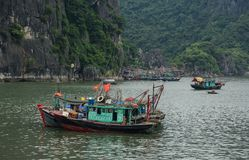 Boats at the jetty in Quang Ninh, Vietnam. Fishing boats docking on Ha Long Bay in Quang Ninh, Vietnam Royalty Free Stock Images