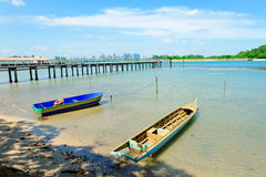 Boats, jetty and Singapore skyline at St John Island Royalty Free Stock Photo