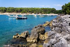 Boats on Kamenjak peninsula by the Adriatic Sea in Premantura, Croatia. stock images
