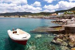 Boats at Kamiros Skala. Small boats moored at Kamiros Skala dock, Rhodes Greece Stock Photo
