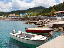 Boats at Kamiros Skala. Small boats moored at Kamiros Skala dock, Rhodes Greece Royalty Free Stock Photos