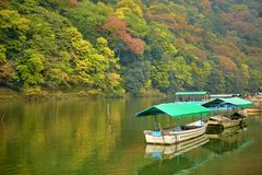Boats on Katsura river at fall in Arashiyama, Kyoto. Japan Royalty Free Stock Photos