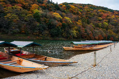 Boats on Katsura river at fall, Arashiyama. Boats on Katsura river at fall in Arashiyama, Kyoto, Japan Stock Images