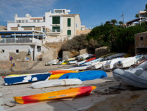 Boats and kayaks on land Stock Images