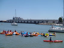 Boats, kayaks, and people in floatation devices wait in McCovey Stock Photography