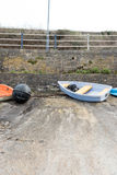 Boats and Kayaks on Seafront Stock Photos