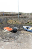 Boats and Kayaks on Seafront Royalty Free Stock Photo