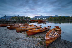Boats at Keswick. Boats on the shore of Derwentwater at Keswick in the Lake District National Park in Cumbria Stock Photo