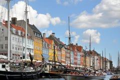 Boats in Kobenhavn, Copenhagen, Denmark. Copenhagen mooring with boats and the typical danish colorful houses in Kobenhavn Stock Photos