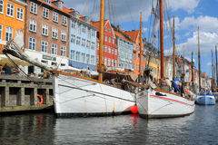 Boats in Kobenhavn, Copenhagen, Denmark. Copenhagen mooring with boats and the typical danish colorful houses in Kobenhavn royalty free stock photo