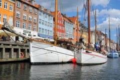 Boats in Kobenhavn, Copenhagen, Denmark. Copenhagen mooring with boats and the typical danish colorful houses in Kobenhavn Royalty Free Stock Photo