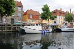 Boats in Kobenhavn, Copenhagen, Denmark. Copenhagen mooring with boats and the typical danish houses in Kobenhavn Royalty Free Stock Photos