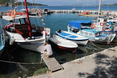 Boats in Kouloura harbour, Corfu. Kouloura is a picturesque fishing village located 30 km south of Corfu town and 7km from the village of Kalami. Corfu is a royalty free stock photography