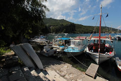 Boats in Kouloura harbour, Corfu. Kouloura is a picturesque fishing village located 30 km south of Corfu town and 7km from the village of Kalami. Corfu is a royalty free stock image