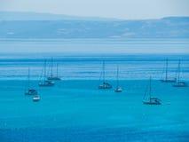 Boats in La Pelosa Beach, Stintino, Italy Stock Image
