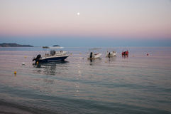 Boats in the Laganas bay at dusk. Boats at the Laganas beach at dusk on Zakynthos Island, Greece stock images