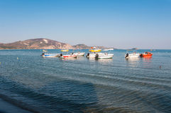 Boats at the Laganas beach in afternoon sun Stock Photo
