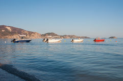 Boats at the Laganas beach in afternoon sun. Boats at the Laganas beach on Zakynthos Island, Greece royalty free stock photography