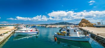 Boats in Laganas port. Small fishermen boats and speed and fast private motorboats moored in the Laganas port, Zante Island, Greece stock photos
