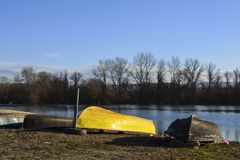 Boats laid up upside down by the river - the end of season. Boats laid up upe down by the river at the end of season Stock Photography