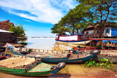 Boats in the lake. Some boats in the lake near the fishing village royalty free stock image
