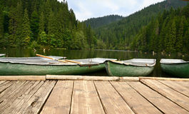 Boats on the lake. View of boats floating on mountain lake Royalty Free Stock Images