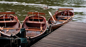Boats on a lake. Three rowing boats moored on a lake Royalty Free Stock Photography