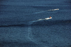 Boats on the lake. Boats racing on a lake tahoe in california Stock Photos