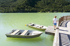 Boats on Lake of Alleghe Royalty Free Stock Images