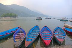 Boats on a lake in Asia Stock Images