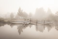 Boats on the lake early morning Stock Images