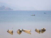 Boats on Lake Fewa. Some boats floating on Lake Fewa in Nepal royalty free stock image