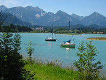 Boats on the lake Forggensee Royalty Free Stock Images