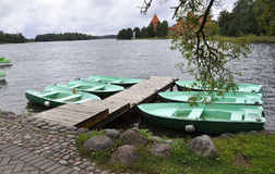 Boats on Lake Galve and Trakai Castle in a rainy day Royalty Free Stock Photography