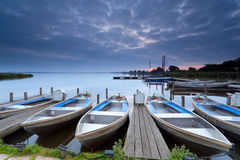 Boats on lake harbor at sunrise Stock Image