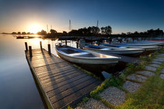 Boats on lake harbor at sunrise Royalty Free Stock Photos